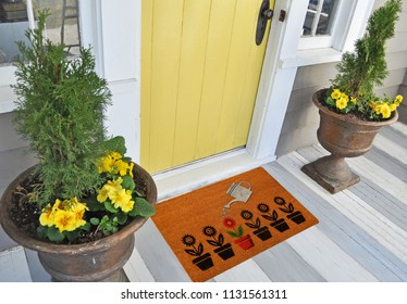 Modern Welcome zute doormat with small black plants and watering colorful plant
