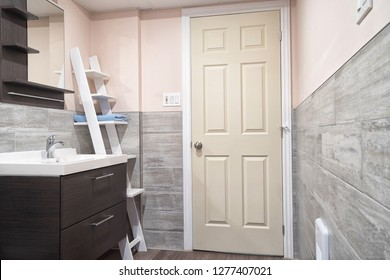 Modern and well organized bathroom with wall covered in ceramic