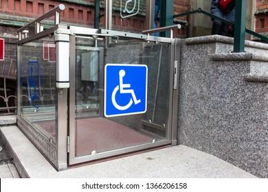 modern wheelchair lift near the building