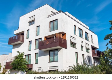 Modern white apartment house with metal balconies seen in Berlin, Germany
