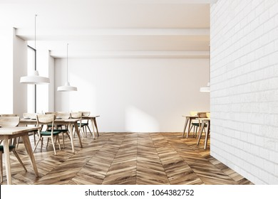 Modern white brick cafe interior with a wooden floor and tables with green chairs standing near them. Large windows and a blank wall. 3d rendering mock up