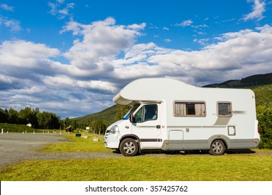 Modern white campervan at camping site in beautiful nature in Hallingdal, Norway.