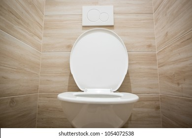 Modern, white ceramic toilet / WC  with weak and powerful flushing  system