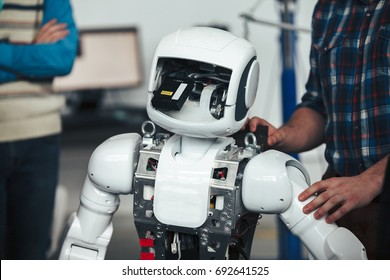 Modern white futuristic humanoid robot close up shot. Electronic components inside