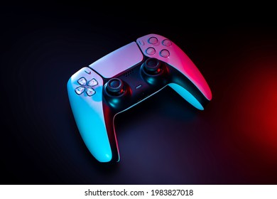Modern white gamepad illuminated in red and blue. Game controller for video games and e-sports on a dark background.