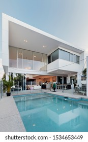 Modern white home with backyard and swimming pool