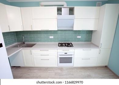Modern white kitchen clean interior design. Elegant kitchen in a luxury house