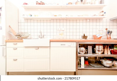 Modern white kitchen with old styled furniture and decors