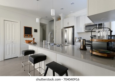 Modern white kitchen with stainless steel appliances. Interior design.