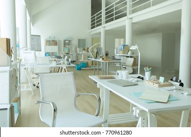 a modern white loft office has good environment for working