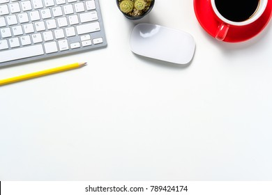 Modern white office desk with keyboard,mouse,pencil and cup of coffee.Top view with copy sapce.Business and strategy concept mockup.