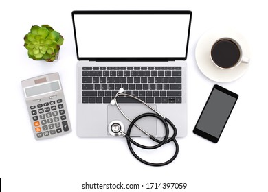 Modern white office desk with laptop computer with blank screen, mobile smart phone, medical stethoscope, calculator and cup of coffee. Top view. Flat lay. Copy space for text.
