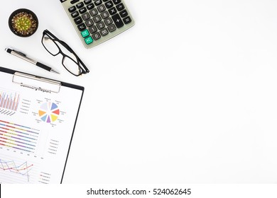 Modern White office desk table with analysis chart or graph, pen, eyeglass and calculator. Top view with copy space.Working desk table concept.