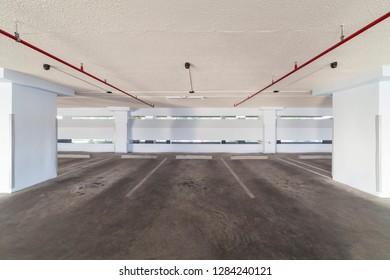 Modern white Parking garage interior ,industrial building.