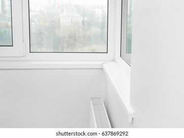 Modern white plastic window at home