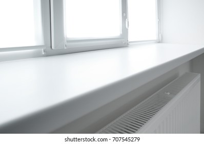 Modern white plastic window sill