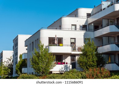 Modern white residential construction with garden seen in Munich, Germany