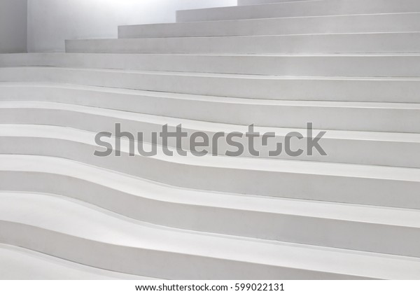 Modern white stairs as an abstract background concept.