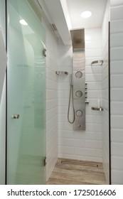 Modern white tiled shower room