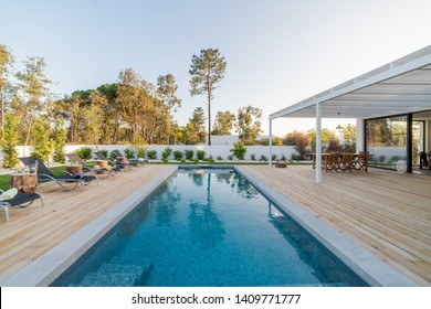 modern white villa with pool and garden