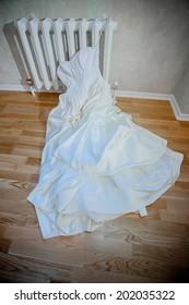 Modern white wedding dress isolated on white background