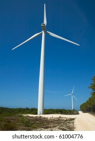 Modern white wind turbine or wind mill producing clean energy