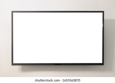 Modern widescreen TV set with blank screen hanging on the wall.