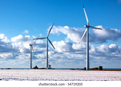 modern windmills on blue sea and bright sky background
