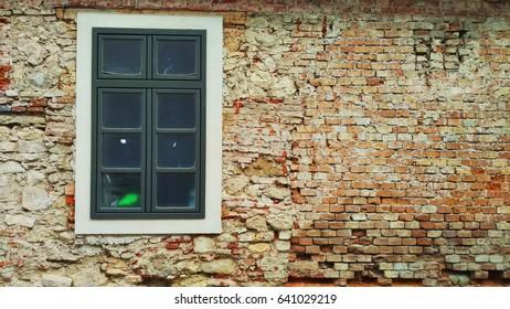 Modern window on an old brick wall - Shutterstock ID 641029219