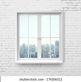 Modern window with skyscraper view in brick wall
