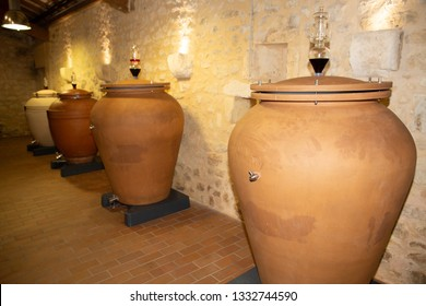 modern wine Olive Oil terracotta amphora in the cellar