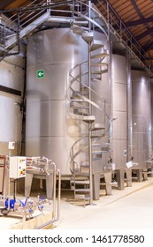 Modern wine production in Italy, inox tanks for wine fermentation close up