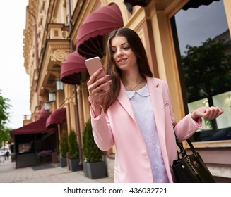 Modern woman in city texting cell phone