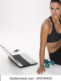 Modern woman with computer notebook practicing sport and recreation