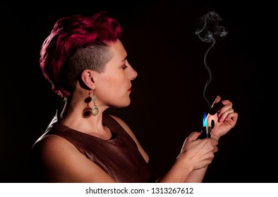 Modern woman with fuchsia hair and a cigar