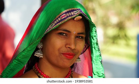 Modern woman with jewellery and costumes. Cultured Hindu woman face closeup with fashionable costumes.