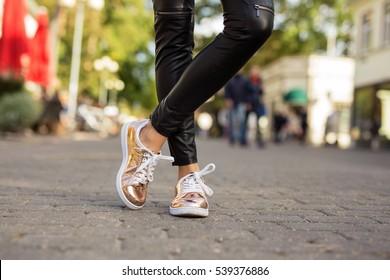 Modern woman in shinny sneakers