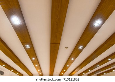 Modern wooden ceiling and light fixtures embedded in the wood panels