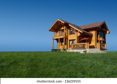 Modern wooden cottage on the green lawn.