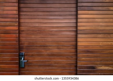 Modern wooden door and wall with electronic lock