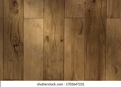 Modern wooden parquet floor in brown colour as a texture background