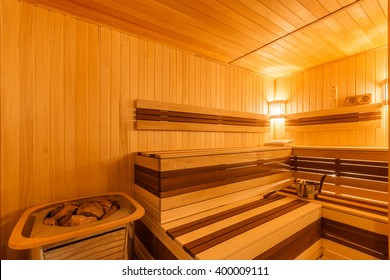 Modern wooden sauna with electric heater