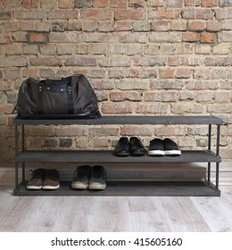 modern wooden shoe rack in the loft interior