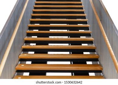modern wooden staircase with iron banister isolated on white background, with clipping path