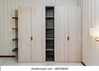 Modern wooden wardrobe in the room
