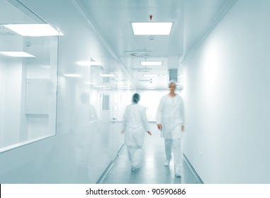 Modern working environment, people walking inside