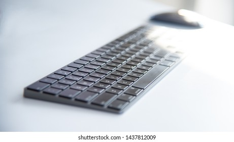 Modern working space with notepad, keyboard, computer or notbook  and pencils on white table in modern office, the working accessories for business man or designer