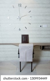 Modern working table with the big clock