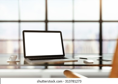 modern workplace with blank laptop at sunrise, mock up