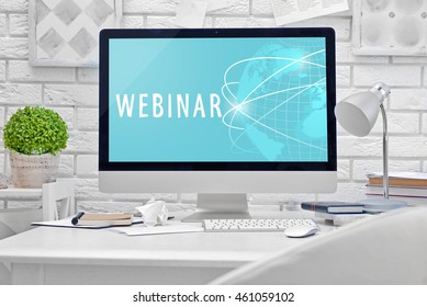 Modern workplace with computer on the table. Webinar concept